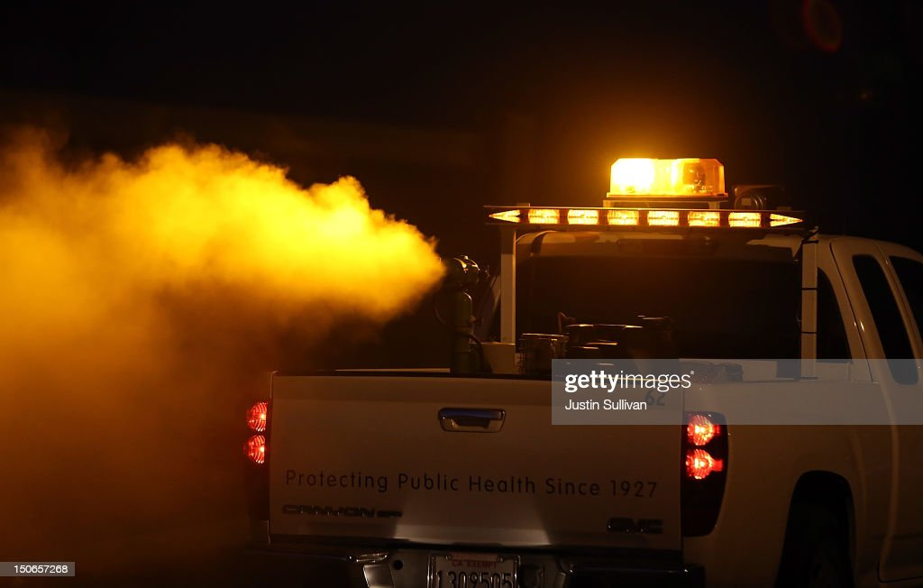 Technicians with the Contra Costa County Mosquito and Vector Control District drive a truck through a neighborhood fogging with Pyrocide 7396 insecticide on August 23, 2012 in Brentwood, California. In the wake of the largest outbreak of the West Nile Virus in the U.S. history, the Contra Costa County Mosquito and Vector Control is fogging areas of the county that have seen a spike in numbers of mosquitoes carrying the West Nile Virus. More than 1,100 people in the Unites States have been infected with West Nile and 41 people have died.