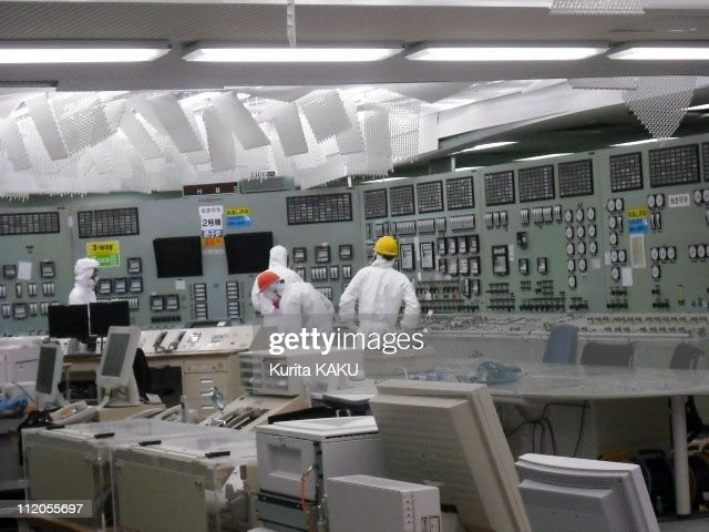 Technicians work in the control room for Unit 2 of Fukushima Daiichi Nuclear Power Station on March 26 2011 in Fukushima in Japan
