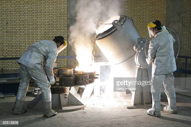 Technicians work inside of a uranium conversion facility producing unit March 30 2005 just outside the city of Isfahan about 254 miles south of...
