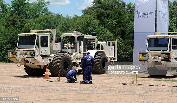 Technicians work next to seismic vibrator trucks during the launching ceremony of the oil exploitation programme in Chaco carried out by US President...