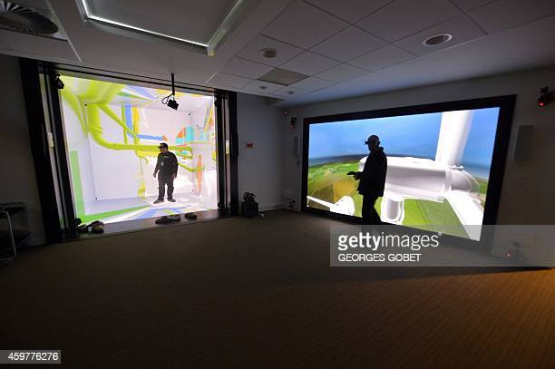 Technicians work on a Cave Automatic Virtual Environment virtual reality theatre and a CAD stereoscopic projection system during their presentation...