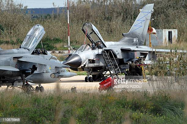 technicians work on Italy's Tornado's jet fighters on March 22 2011 at TrapaniBirgi airbase in Sicily Western and Arab warplanes are converging on...