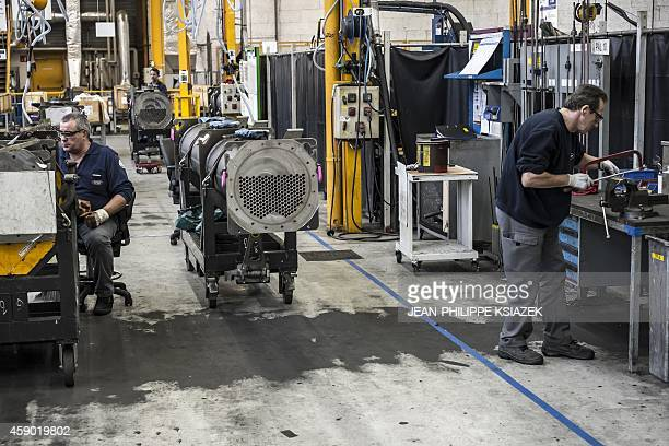 carrier air conditioning factory. technicians work on november 6 2014 in the heating air conditioning and ventilation carrier factory m