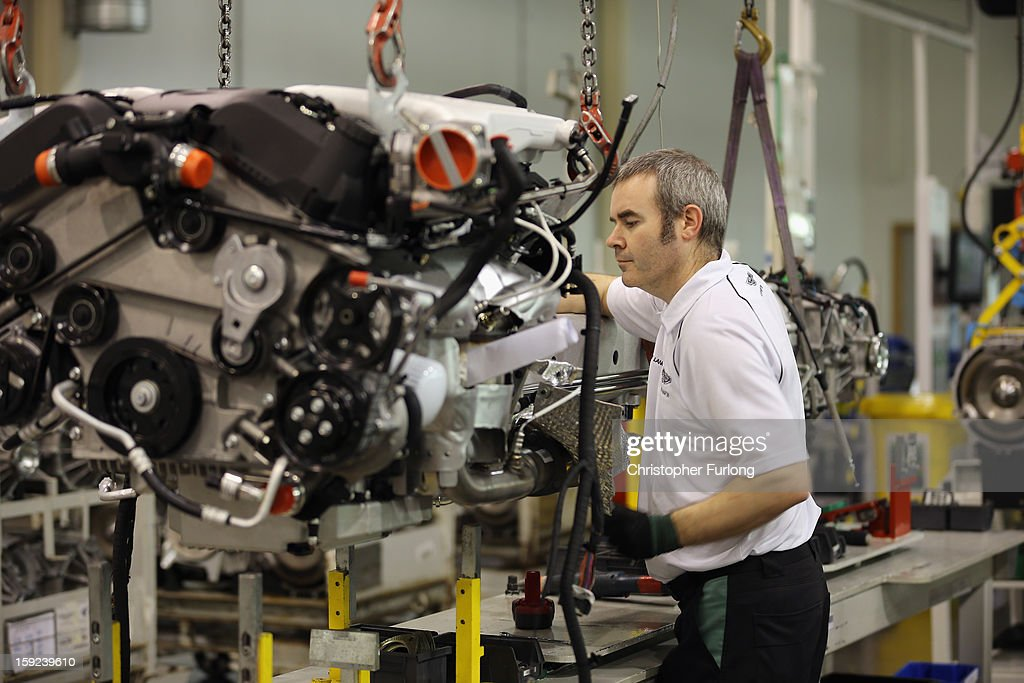 Technicians work on the assembly line building Aston Martin motor cars at the company headquarters and production plant on January 10, 2013 in Gaydon, England. The iconic British brand is celebrating its 100th anniversary. Lionel Martin and Robert Bamford created Bamford & Martin on January 15 1913, which later became Aston Martin in honour of Bamford's wins at the Aston Clinton Hillclimb in Buckinghamshire.