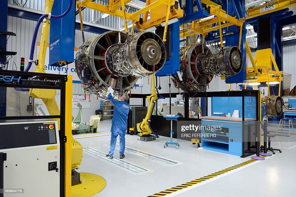 Technicians work on the assembly line of French aerospace and defence group Safran putting together SECMA-SAFRAN CFM 56 jet engines for commercial and military aircraft, on March 18, 2013 at the SNECMA Villaroche site in Moissy-Cramayel, south east of Paris. AFP PHOTO ERIC FEFERBERG