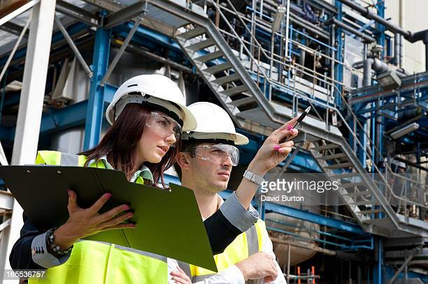 technicians working in industrial chemical plant