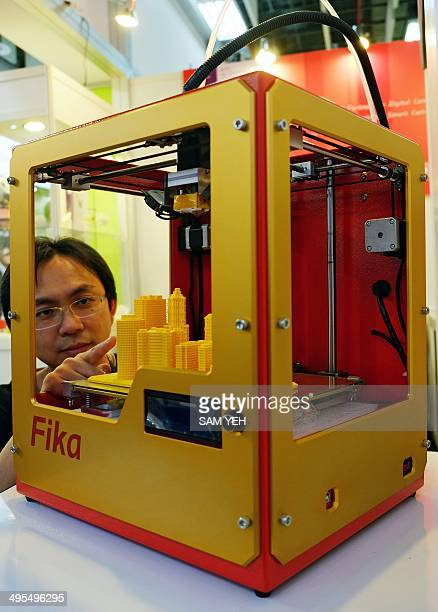A technicism introduces a Fika II 3D printer on display at the Computex tech show in Taipei on June 4 2014 More than 1500 exhibitors including some...