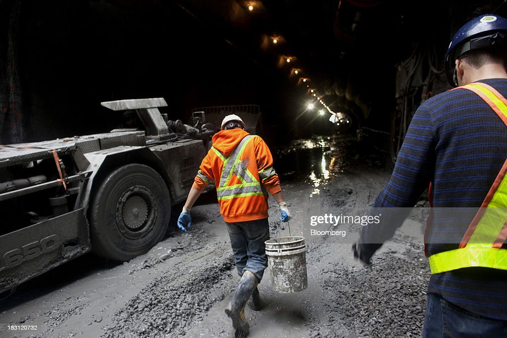 A Technicore Underground employee carries a bucket during construction of the Billy Bishop Toronto City Airport pedestrian tunnel in Toronto, Ontario, Canada, on Friday, Oct. 4, 2013. The tunnel, which connects the Toronto mainland at the foot of Eireann Quay to the airport terminal, will have moving sidewalks, an elevator at both ends, and an escalator on the island side. Photographer: Brett Gundlock/Bloomberg via Getty Images