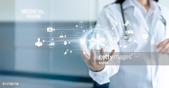 Technology Innovation and medicine concept. Doctor and medical network connection with modern virtual screen interface in hand on hospital background : Stock Photo