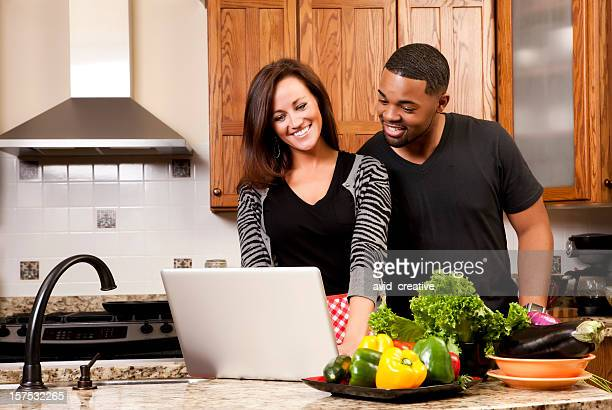 Technology: Mixed-Race Couple in Kitchen