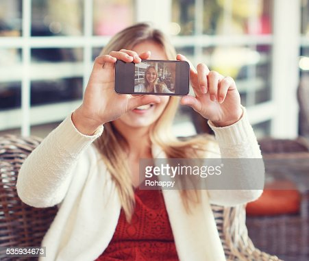 Technology, mobile and people concept - happy woman makes self-p : Stock Photo