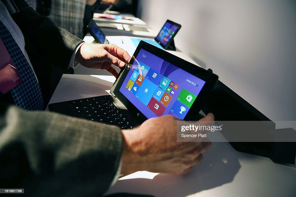 Technology writers try-out the new line-up of second generation Surface tablets on September 23, 2013 in New York City.The new Surface family includes two products, Surface 2 and Surface Pro 2. Improvements on the tablets include better battery life, faster processors and Dolby Digital sound. The new devices will be in stores on Oct. 22.