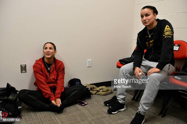Tecia Torres and girlfriend Raquel Pennington wait backstage during the UFC 218 event inside Little Caesars Arena on December 02 2017 in Detroit...