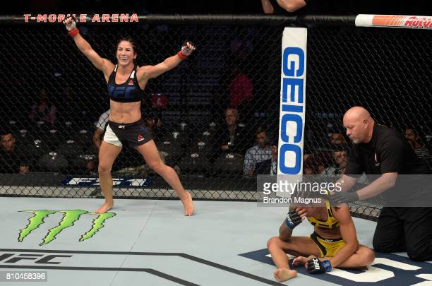 Tecia Torres celebrates after her submission victory over Juliana Lima of Brazil in their women's strawweight bout during The Ultimate Fighter Finale...