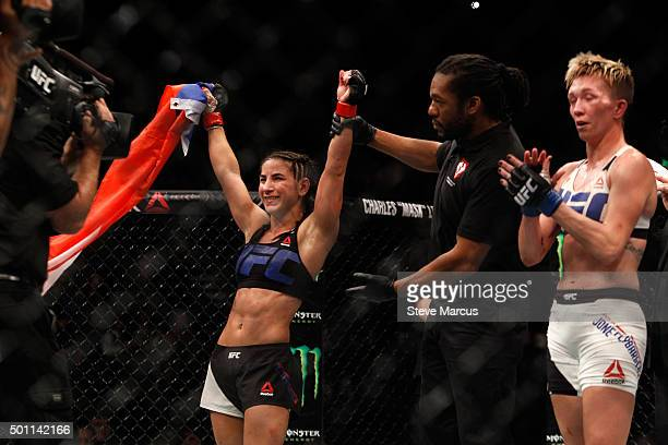 Tecia Torres celebrates her victory over Jocelyn JonesLybarger in a strawweight fight during UFC 194 on December 12 2015 in Las Vegas Nevada