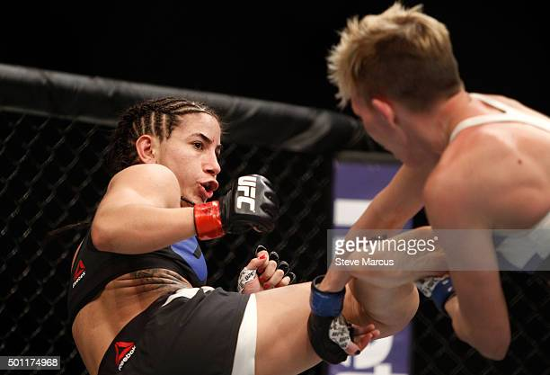 Tecia Torres kicks at Jocelyn JonesLybarger in a strawweight fight during UFC 194 at MGM Grand Garden Arena on December 12 2015 in Las Vegas Nevada