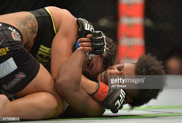 Tecia Torres of the United States controls the body of Angela Hill of the United States in their women's strawweight bout during the UFC 188 event at...
