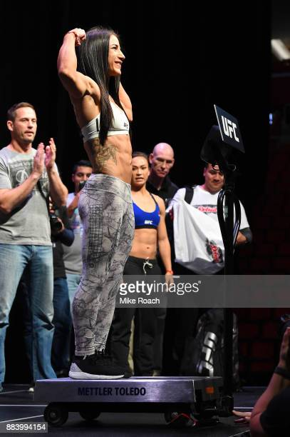 Tecia Torres poses on the scale during the UFC 218 weighin inside Little Caesars Arena on December 1 2017 in Detroit Michigan