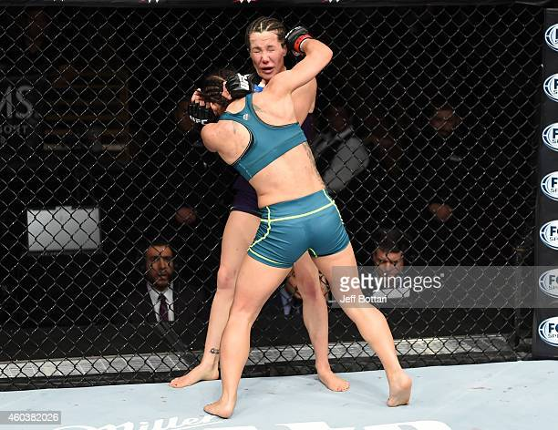 Tecia Torres punches Angela Magana in their strawweight fight during The Ultimate Fighter Finale event inside the Pearl concert theater at the Palms...