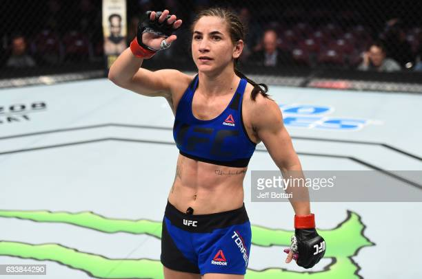 Tecia Torres raises her hand after facing Bec Rawlings of Australia in their women's strawweight bout during the UFC Fight Night event at the Toyota...