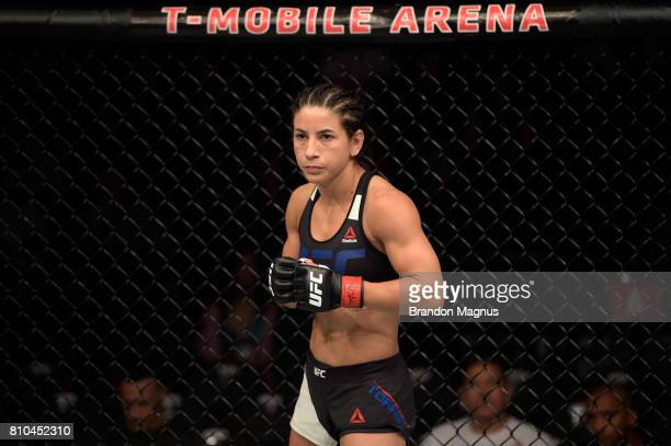 Tecia Torres stands in the Octagon prior to her women's strawweight bout against Juliana Lima of Brazil during The Ultimate Fighter Finale at TMobile...