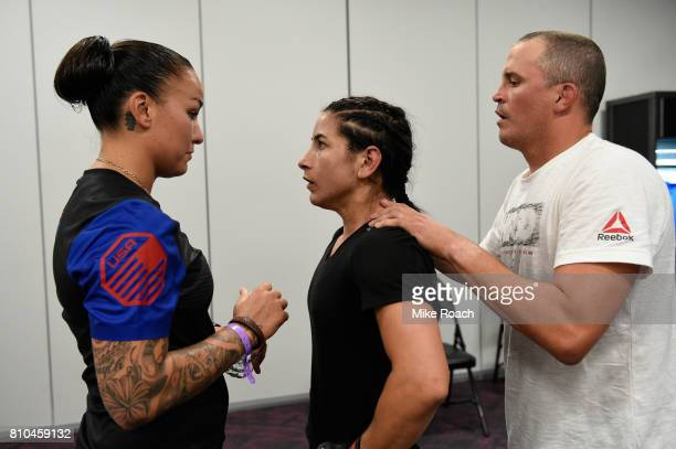 Tecia Torres warms up with girlfriend Raquel Pennington prior to her bout against Juliana Lima during The Ultimate Fighter Finale at TMobile Arena on...