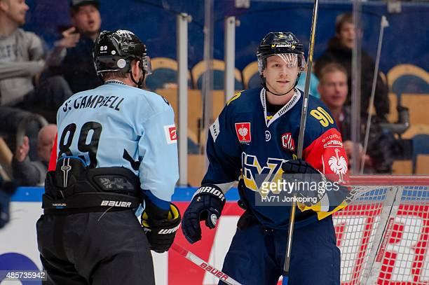 Ted Brithen of HV71 Scott Campbell of Sonderjyske during the Champions Hockey League group stage game between HV71 Jonkoping and SonderjyskE Vojens...