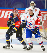 Ted Brithén of HV71 and Lukas Frick of Kloten Flyers struggling in front of Martin Gerber Goaltender of Kloten Flyers during the Champions Hockey...