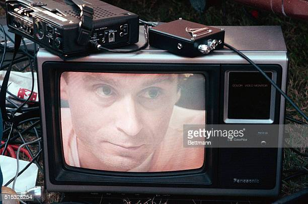 Ted Bundy's image on a television screen on the lawn of the Florida State Prison | Location Starke Florida USA