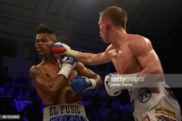 Ted Cheeseman of Great Britain punches Aristides Quintero of Panama during the SuperWelterweight fight between Ted Cheeseman and Aristides Quintero...