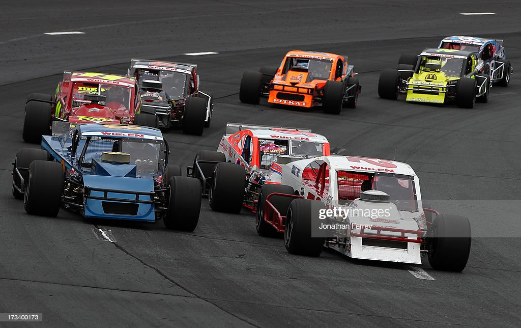 <a gi-track='captionPersonalityLinkClicked' href=/galleries/search?phrase=Ted+Christopher&family=editorial&specificpeople=790817 ng-click='$event.stopPropagation()'>Ted Christopher</a>, driver of the #3 Chevrolet, and Doug Coby, driver of the #52 Furnace & Duct/Seekonk Grand Prix Chevrolet, lead the field during the NASCAR Whelen Modified Tour Town Fair Tire 100 at New Hampshire Motor Speedway on July 13, 2013 in Loudon, New Hampshire.