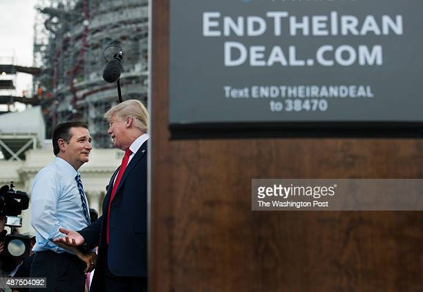 Ted Cruz and Donald Trump greet each other on stage at the Stop The Iran Nuclear Deal protest in front of the US Capitol in Washington DC on...