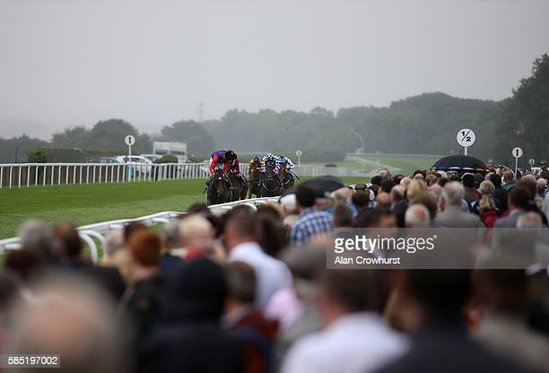 Ted Durcan riding Labyrinth looks around for any danger as they win The CPA Scaffolding Maiden Filles' Stakes at Salisbury racecourse on August 02...