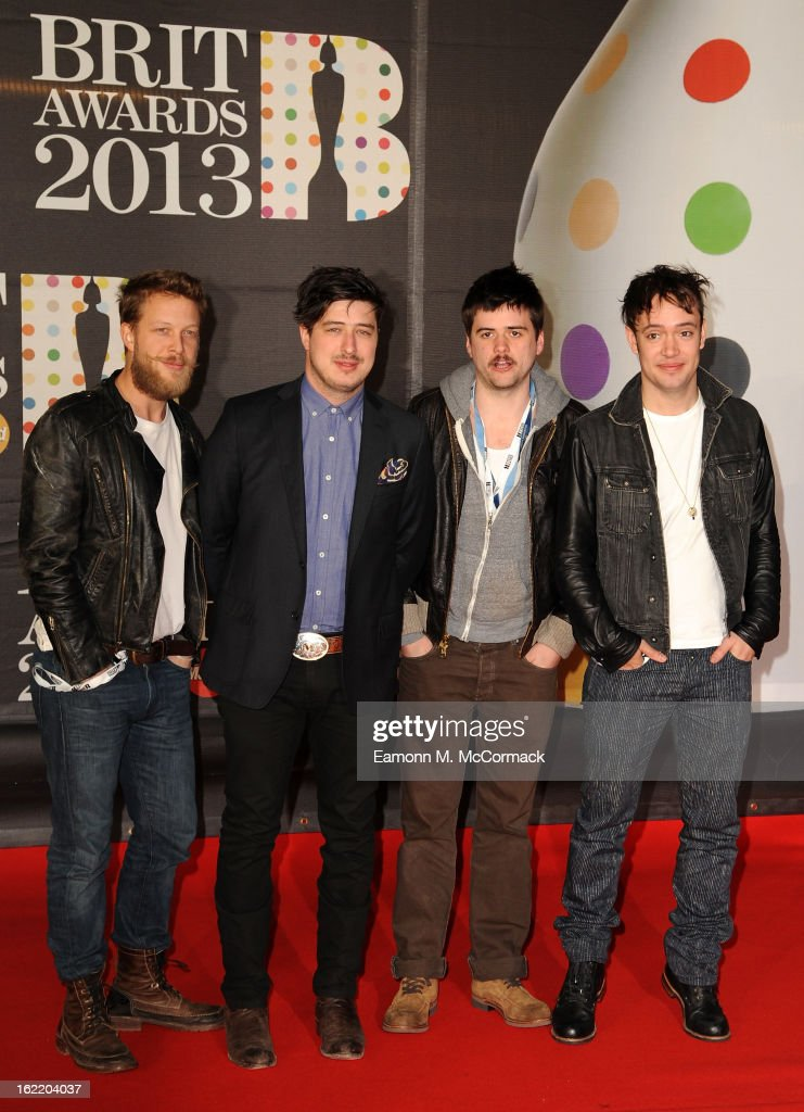 Ted Dwane, Marcus Mumford, Winston-Marshall and Ben Lovett of Mumford & Sons attend the Brit Awards 2013 at the 02 Arena on February 20, 2013 in London, England.