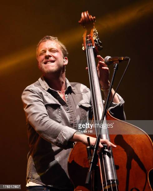 Ted Dwane of Mumford Sons performs at Forest Hills Stadium on August 28 2013 in the Queens borough of New York City