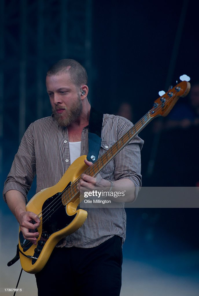 Ted Dwane of Mumford & Sons performs at their biggest headline show to date during the Summer Stampede tour at Olympic Park on July 6, 2013 in London, England.