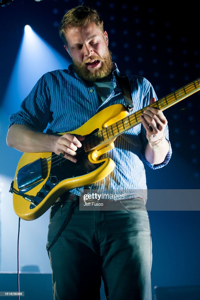 Ted Dwayne of Mumford and Sons performs at the Susquehanna Bank Center on February 16, 2013 in Camden, New Jersey.
