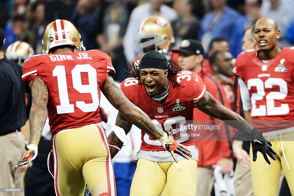 Ted Ginn #19 celebrates awith Dashon Goldson #38 of the San Francisco 49ers after a long punt return against the Baltimore Ravens during Super Bowl XLVII at the Mercedes-Benz Superdome on February 3, 2013 in New Orleans, Louisiana.