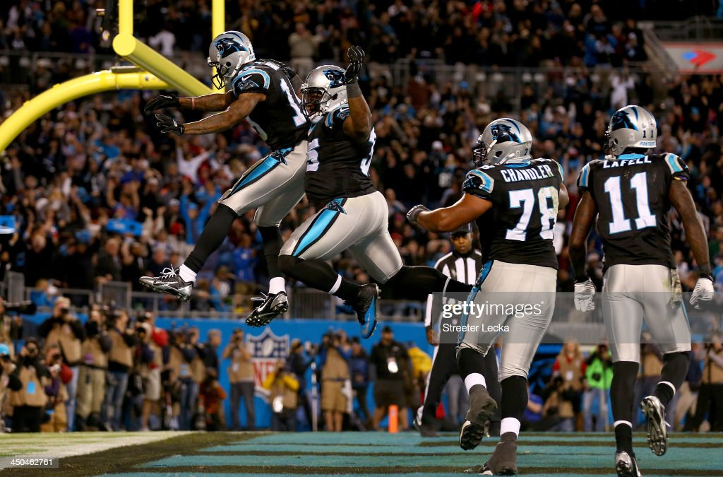 Ted Ginn #19 celebrates scoring the game winning touchdown with teammate Mike Tolbert #35 of the Carolina Panthers during their game against the New England Patriots at Bank of America Stadium on November 18, 2013 in Charlotte, North Carolina.