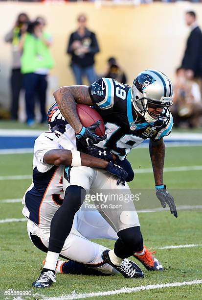 Ted Ginn Jr #19 of the Carolina Panthers gets tackled by Kayvon Webster of the Denver Broncos during Super Bowl 50 at Levi's Stadium on February 7...