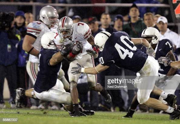 Ted Ginn Jr #7 of the Ohio St Buckeyes is tackled by Dan Connor and Paul Posluszny of the Penn State Nittany Lions during a game October 8 2005 at...