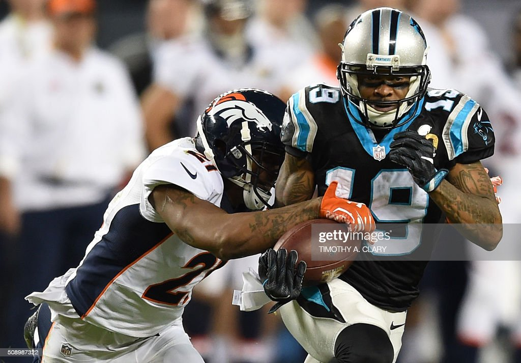 Ted Ginn, Jr. (R) of the Carolina Panthers is pursued by Aqib Talib (L) of the Denver Broncos during Super Bowl 50 at Levi's Stadium in Santa Clara, California February 7, 2016. / AFP / TIMOTHY A. CLARY