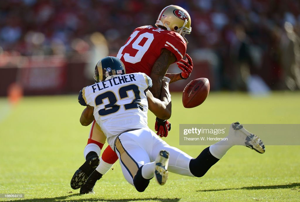 Ted Ginn Jr #19 of the San Francisco 49ers returning a kickoff has the ball stripped away by Bradley Fletcher #32 of the St. Louis Rams during the first quarter of an NFL football game at Candlestick Park on November 11, 2012 in San Francisco, California. The 49ers recovered the the ball on the play.