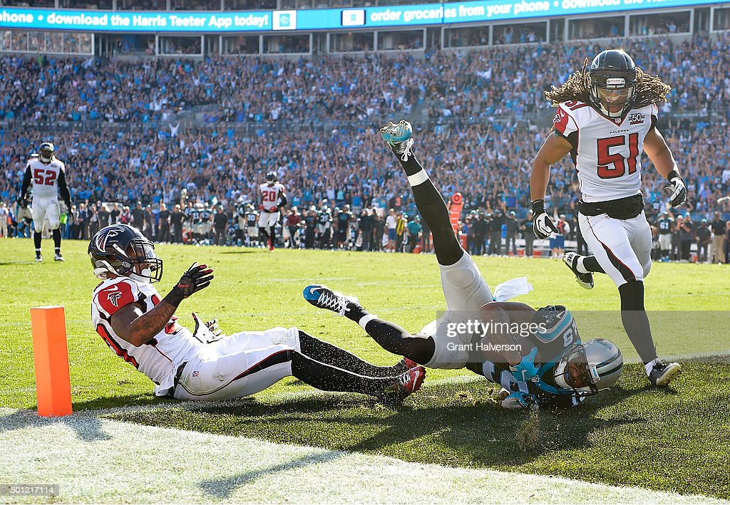 Ted Ginn #19 of the Carolina Panther makes a touchdown catch against <a gi-track='captionPersonalityLinkClicked' href=/galleries/search?phrase=Ricardo+Allen&family=editorial&specificpeople=7172781 ng-click='$event.stopPropagation()'>Ricardo Allen</a> #37 and <a gi-track='captionPersonalityLinkClicked' href=/galleries/search?phrase=Philip+Wheeler&family=editorial&specificpeople=2253975 ng-click='$event.stopPropagation()'>Philip Wheeler</a> #51 of the Atlanta Falcons during the first quarter of their game at Bank of America Stadium on December 13, 2015 in Charlotte, North Carolina.