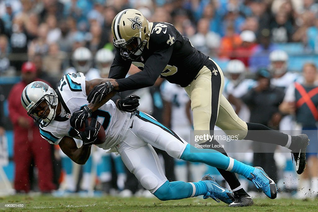 Ted Ginn #19 of the Carolina Panthers makes a catch against <a gi-track='captionPersonalityLinkClicked' href=/galleries/search?phrase=Kenny+Phillips&family=editorial&specificpeople=2145127 ng-click='$event.stopPropagation()'>Kenny Phillips</a> #38 of the New Orleans Saints in the first quarter during their game at Bank of America Stadium on September 27, 2015 in Charlotte, North Carolina.