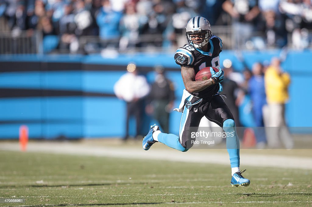 Ted Ginn #19 of the Carolina Panthers runs the ball during the NFC Divisional Playoff Game against the San Francisco 49ers at Bank of America Stadium on January 12, 2014 in Charlotte, North Carolina.