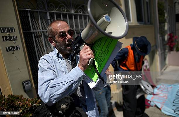 Ted Gullicksen with the San Francisco Tenany Union speaks during a demonstration outside of an apartment building that allegedly evicted all of the...