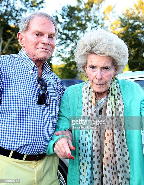 Ted Hartley and Dina Merrill attend the East Hampton Library's Authors Night 2013 at Gardiner's Farm on August 10 2013 in East Hampton New York