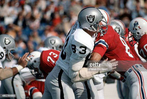 Ted Hendricks of the Oakland Raiders hits Russ Francis of the New England Patriots during an NFL football game October 3 1976 at Schaefer Stadium in...