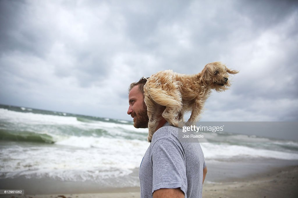 Ted Houston and his dog Kermit visit the beach as Hurricane Matthew approaches the area on October 6 2016 in Palm Beach United States The hurricane...